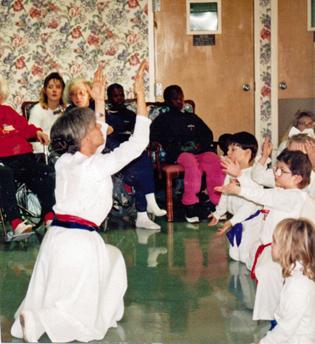 Qaumaniq dancing with children